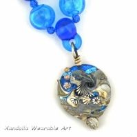 Nautilus Series pendant and necklace on hollow beads
